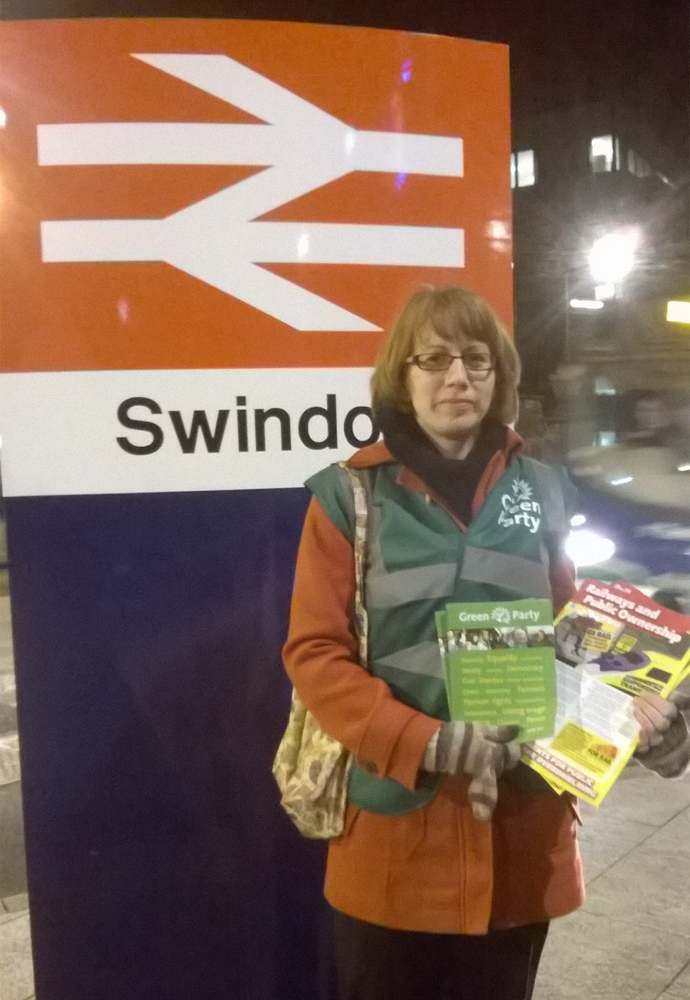 Photograph of Poppy Hebden-Leeder at Swindon Rail Station protesting against 2015 rail fare increases